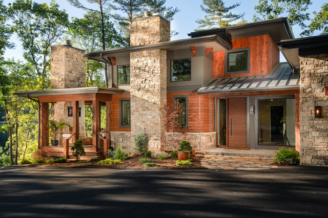 Inspiration for a large rustic multicolored three-story mixed siding house exterior remodel in Other with a shed roof and a metal roof