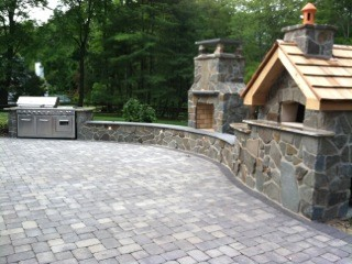 Outdoor Kitchen with Wood Fired Pizza Oven Kit traditional-exterior