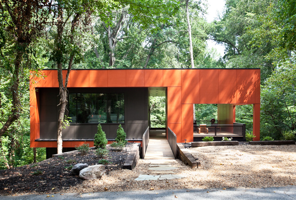 Example of a mid-sized minimalist orange one-story exterior home design in Atlanta