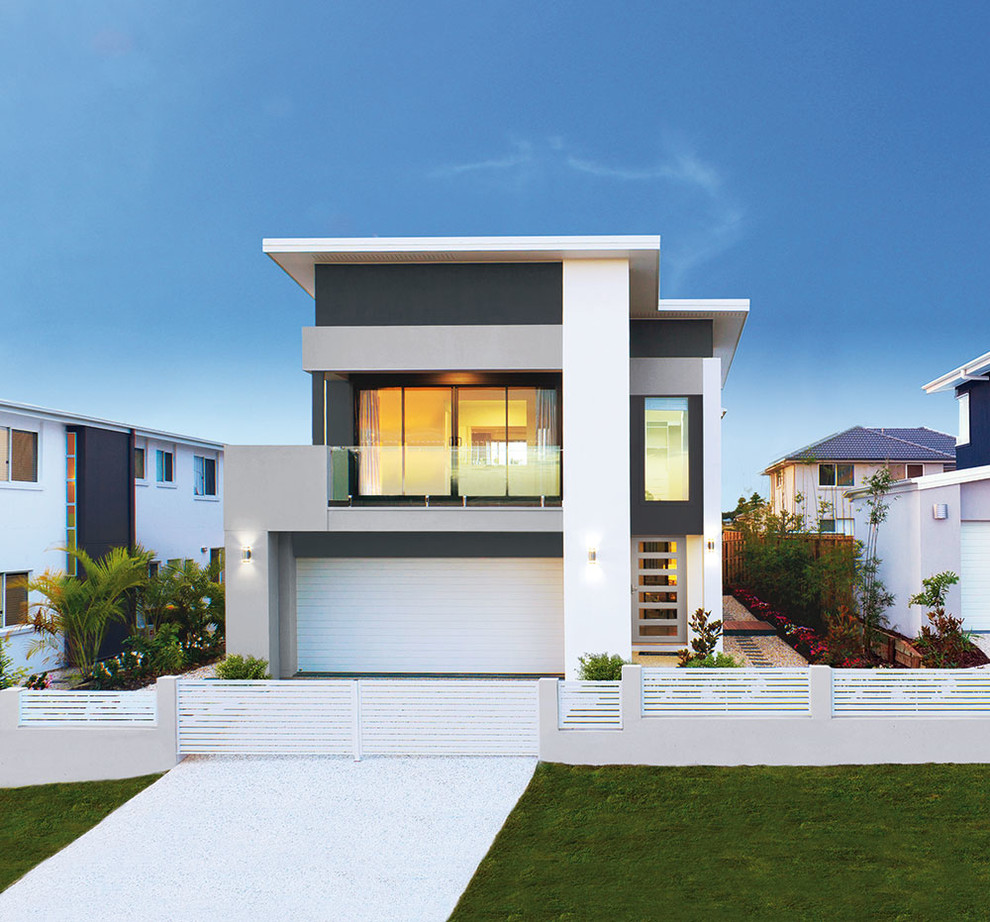 Inspiration for a mid-sized contemporary two-storey exterior in Brisbane with a flat roof.