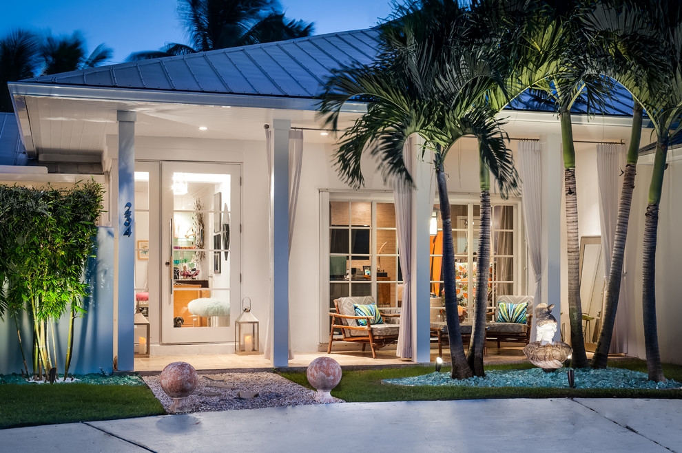 Example of a trendy white exterior home design in Miami