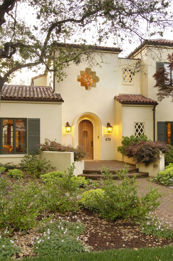 Inspiration for a mediterranean two-story stucco exterior home remodel in San Francisco with a tile roof