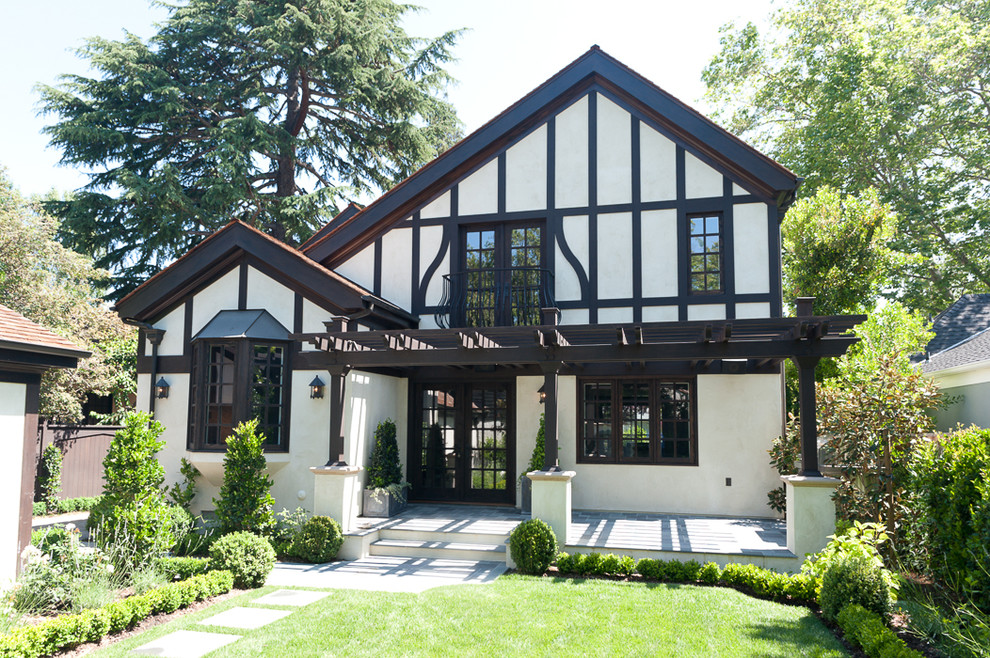 Example of a mid-sized classic white two-story stucco exterior home design in San Francisco