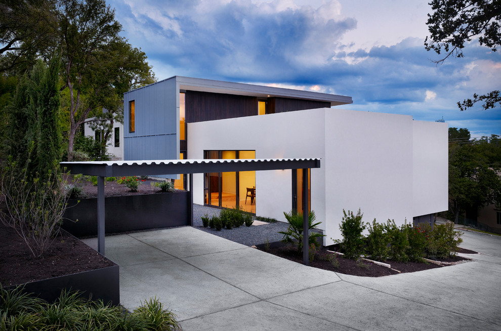 Example of a minimalist metal exterior home design in Austin