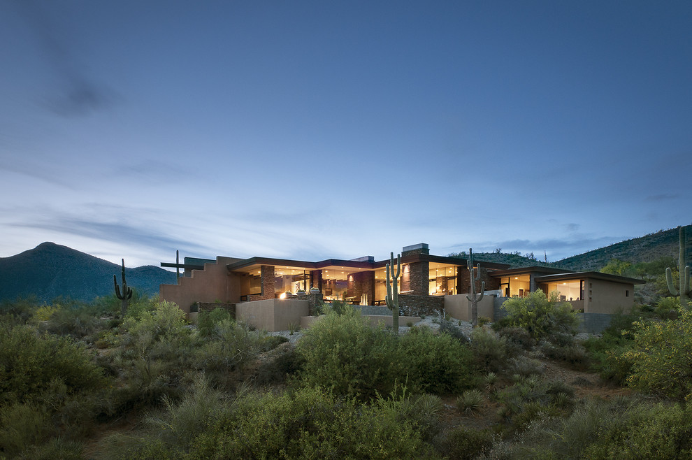 Inspiration for a southwestern stucco exterior home remodel in Phoenix