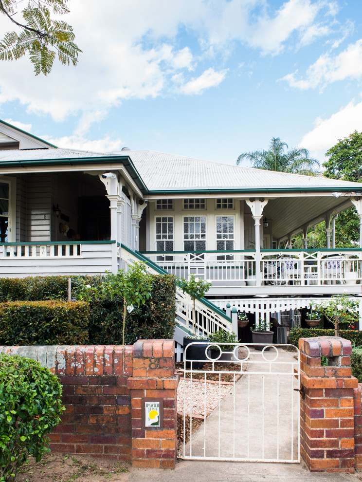 Large traditional gray two-story wood gable roof idea in Brisbane