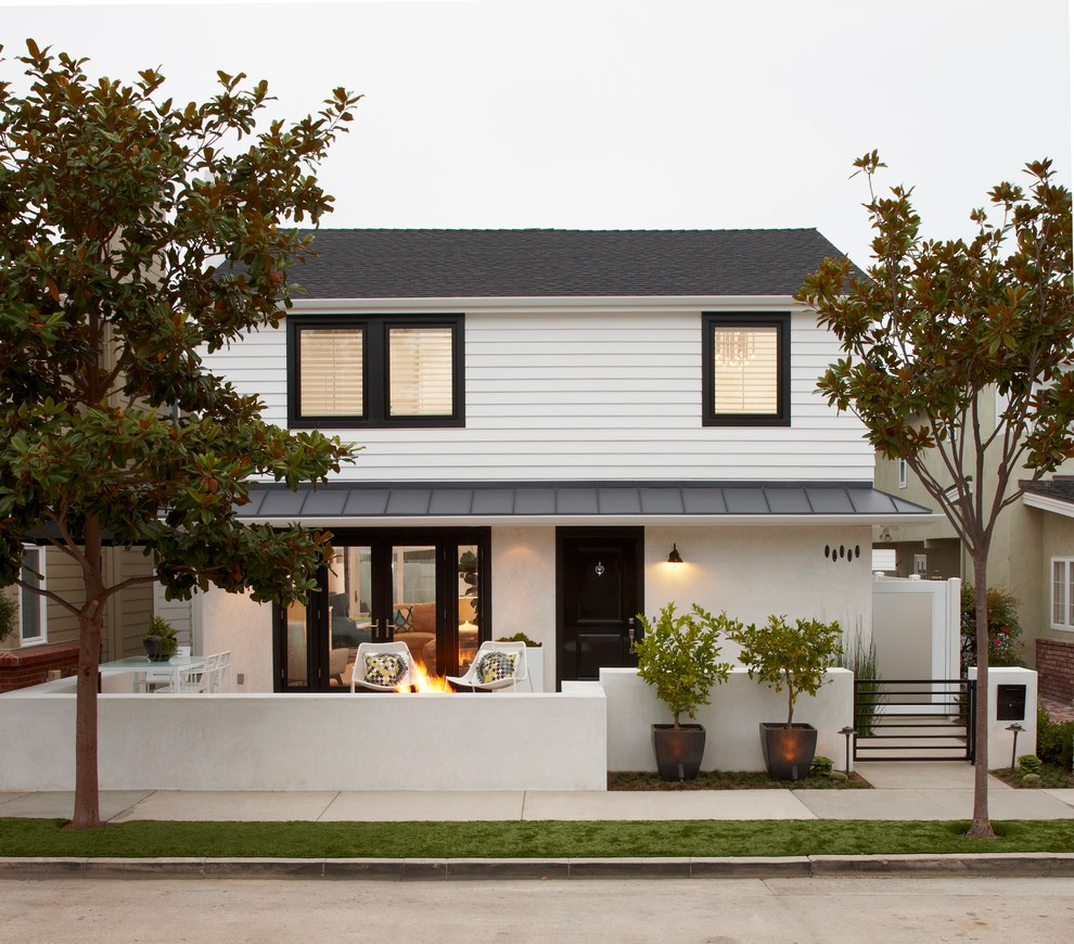 Inspiration for a transitional two-story exterior home remodel in Orange County with a mixed material roof