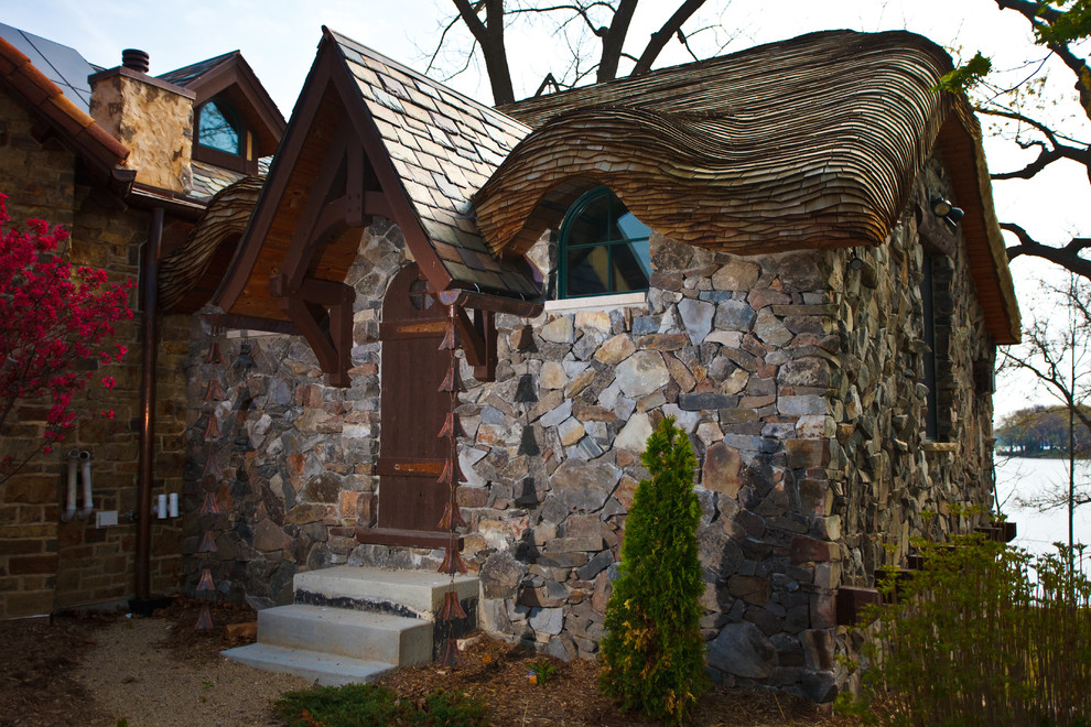 Example of a small eclectic stone exterior home design in Milwaukee
