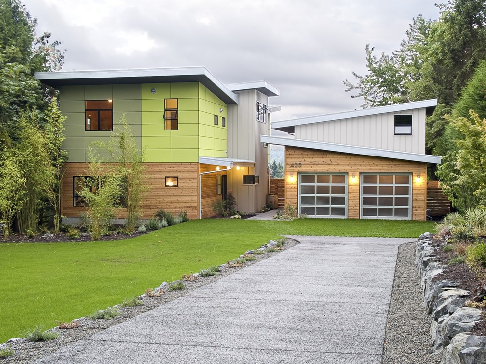 Trendy wood apartment exterior photo in Seattle with a shed roof