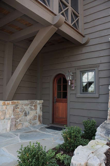 Old World Lakehouse rustic-exterior