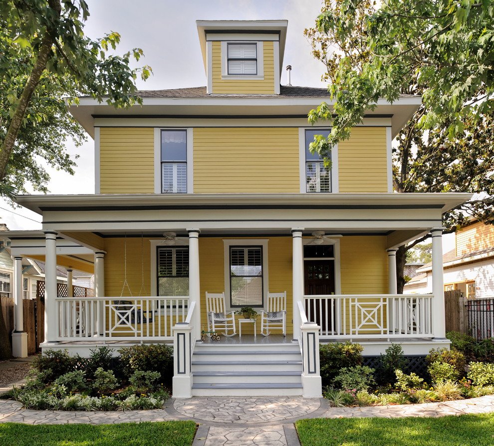 Inspiration for a timeless yellow wood exterior home remodel in Houston