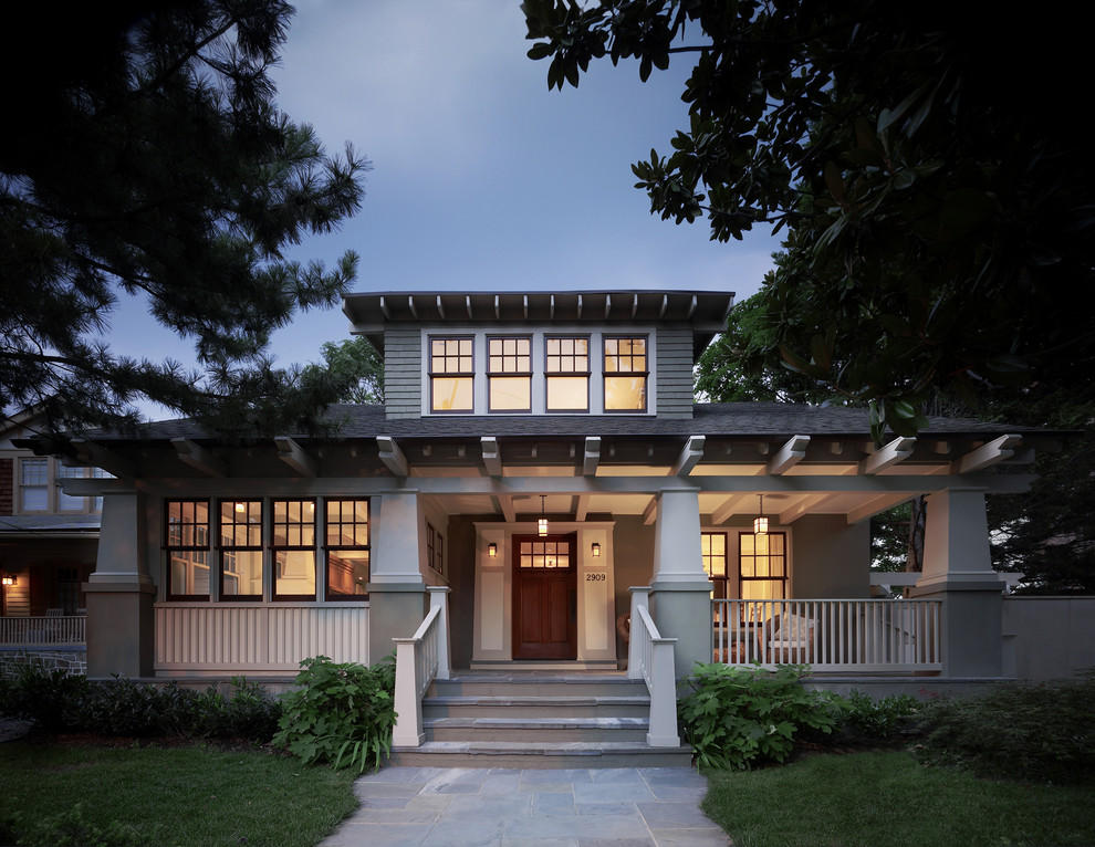 Example of an arts and crafts green two-story exterior home design in DC Metro