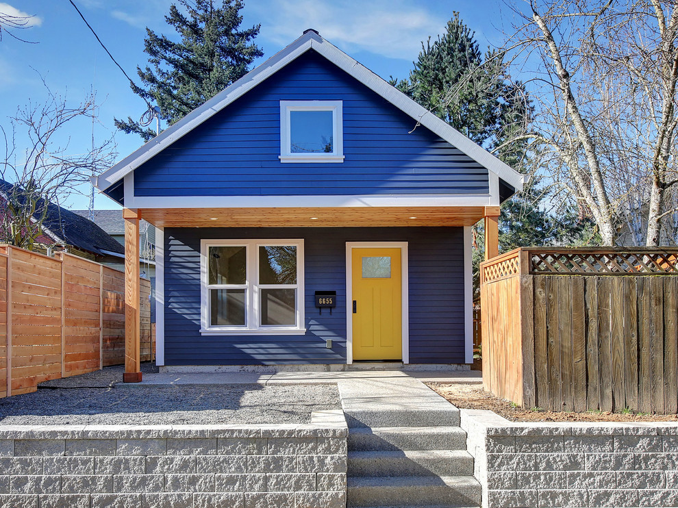 Small traditional blue one-story wood exterior home idea in Portland with a shingle roof