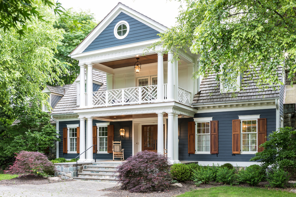 Inspiration for a timeless blue two-story exterior home remodel in DC Metro with a shingle roof
