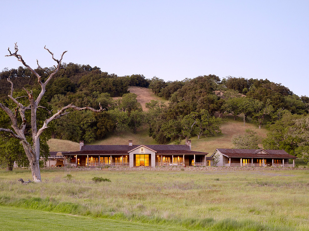 Example of a mountain style one-story exterior home design in San Francisco