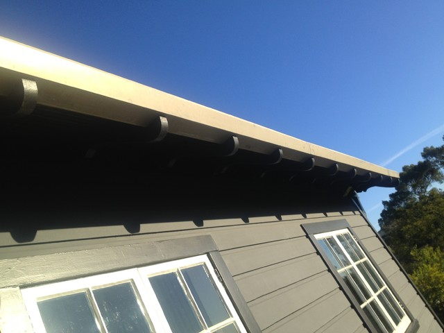 Primed And Painted Bonderized Steel Gutters On Pool House