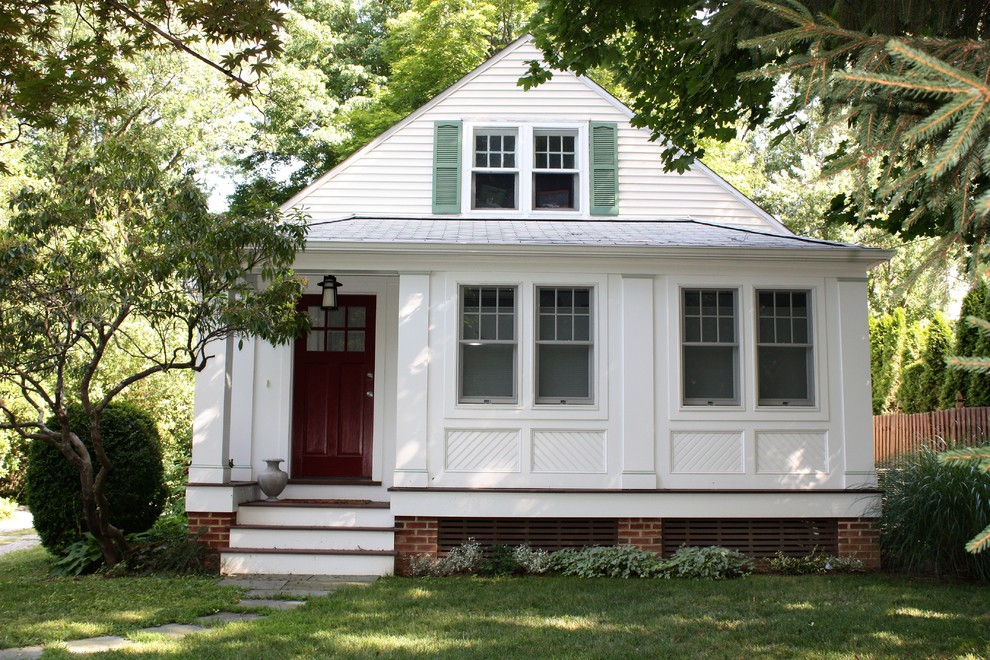 Small elegant white one-story wood exterior home photo in Philadelphia with a shingle roof