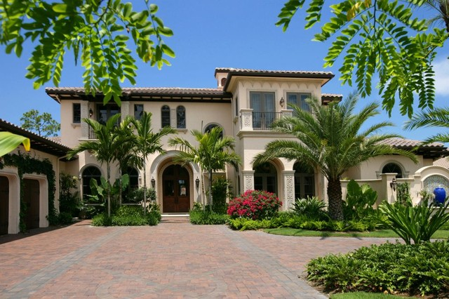 Large Mediterranean Beige Two Story Stucco Exterior Home Idea In Miami With  A Hip Roof