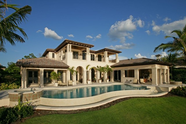 Inspiration For A Mediterranean Beige Two Story Stucco Exterior Home  Remodel In Miami
