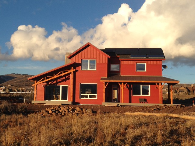 Mid-sized country red two-story exterior home photo in Salt Lake City
