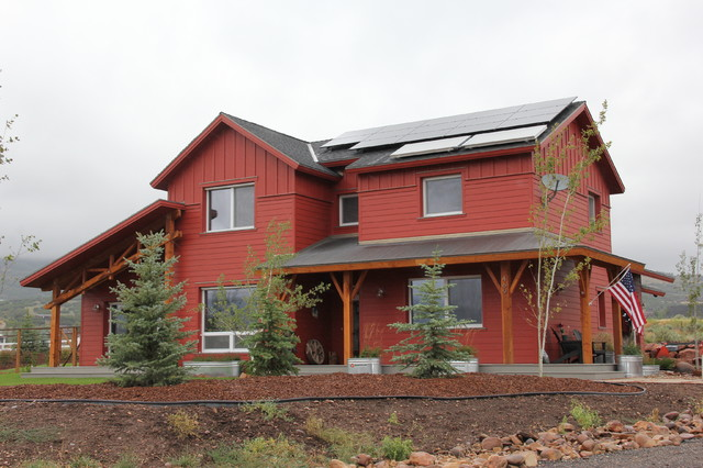 Inspiration for a mid-sized country red two-story exterior home remodel in Salt Lake City