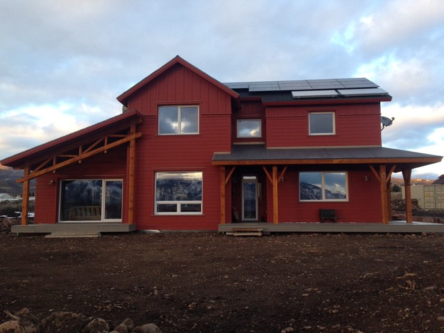 Example of a mid-sized farmhouse red two-story exterior home design in Salt Lake City