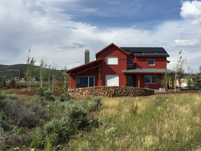 Example of a mid-sized cottage red two-story wood exterior home design in Salt Lake City