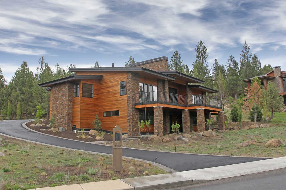 Inspiration for a large transitional two-story mixed siding house exterior remodel in Portland