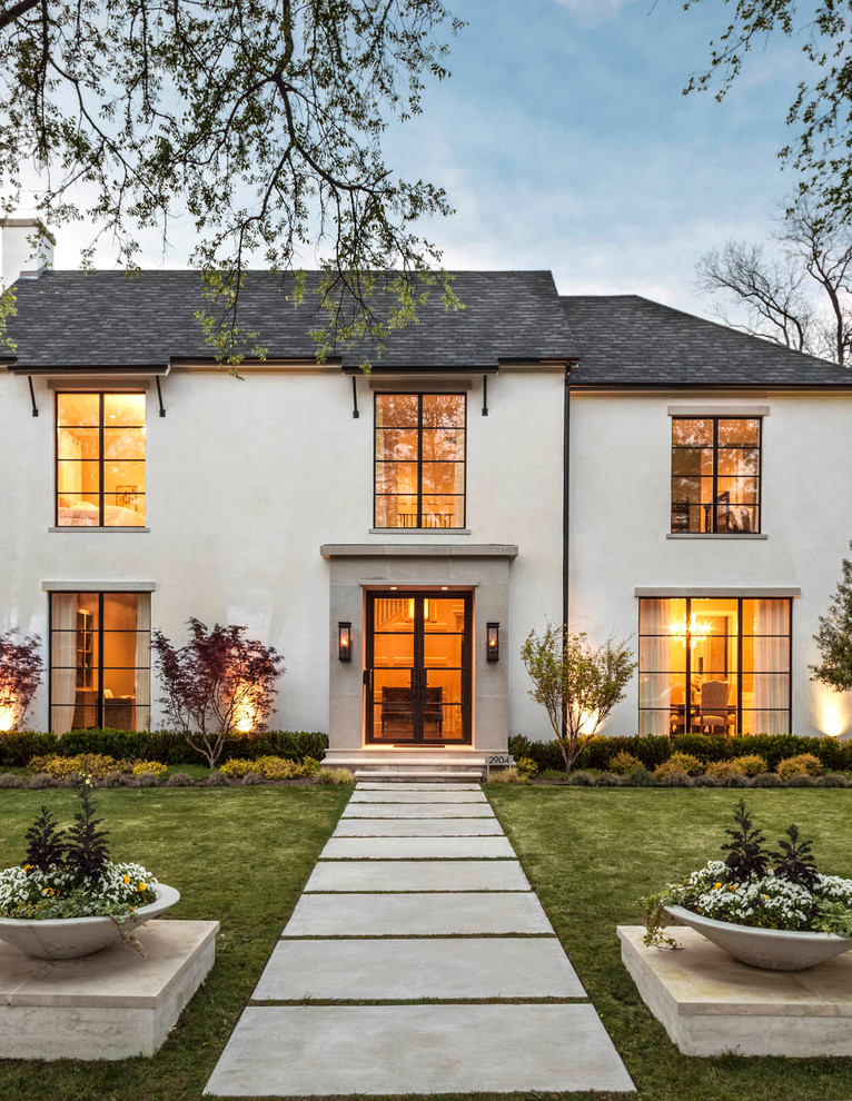 Example of a transitional beige two-story stucco exterior home design in Dallas