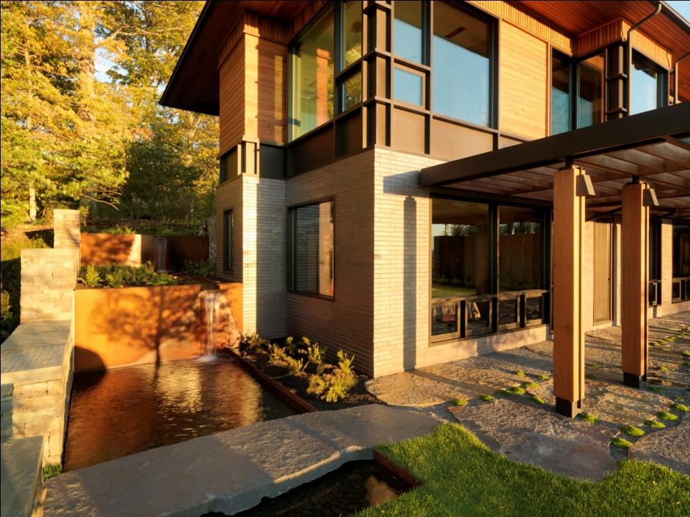 Mountain style wood exterior home photo in Burlington