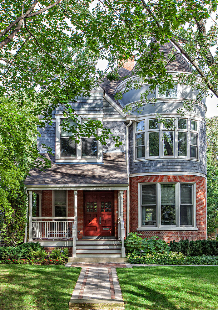 Traditional blue three-story mixed siding gable roof idea in Chicago
