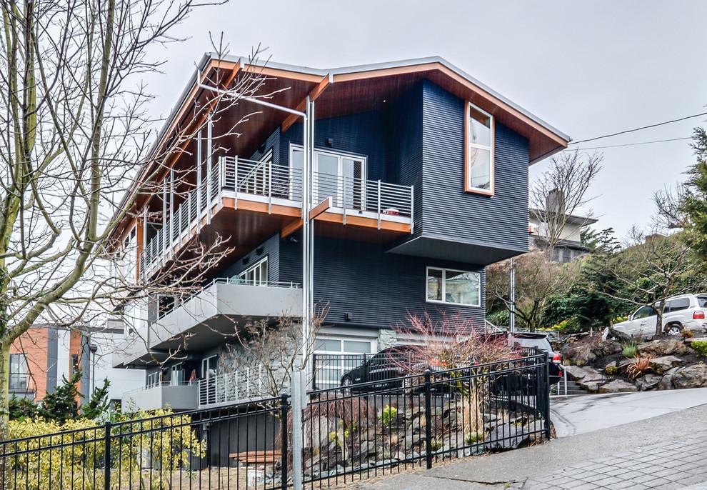 Large modern blue split-level metal exterior home idea in Seattle