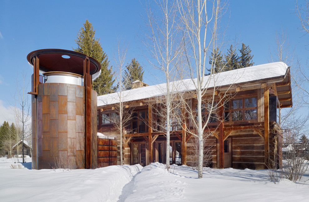 Example of a mountain style mixed siding exterior home design in Salt Lake City