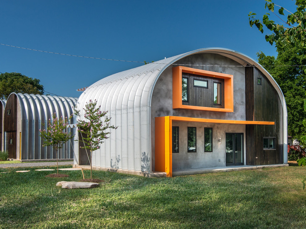 Inspiration for a mid-sized industrial orange two-story metal house exterior remodel in Nashville with a metal roof