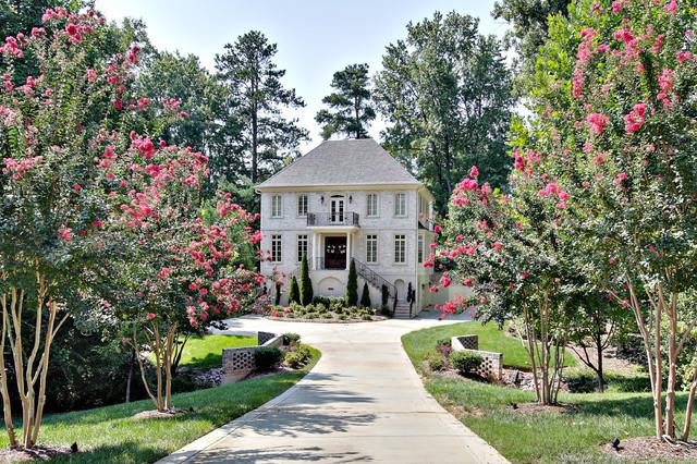 Elegant brick exterior home photo in Raleigh