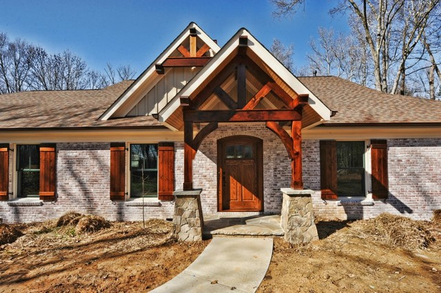 Ranch to rustic traditional exterior other by for Stone and cedar homes
