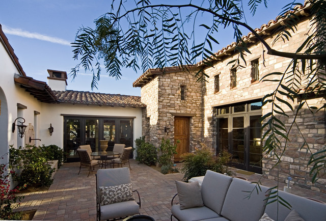 mediterranean exterior by Sennikoff Architects