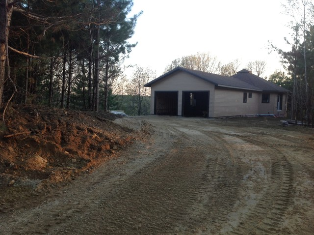 Mid-sized craftsman one-story concrete fiberboard exterior home idea in Other