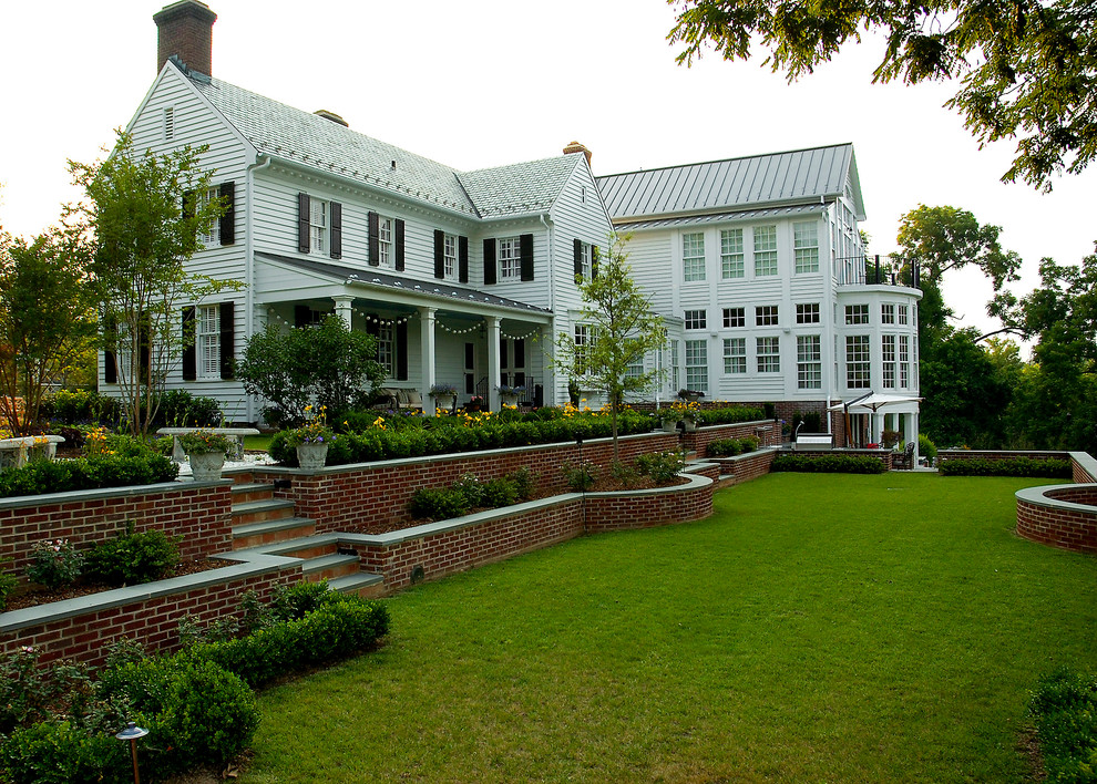 Large traditional white two-story wood exterior home idea in Richmond with a mixed material roof