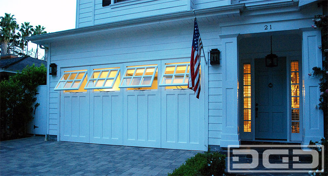 Real Carriage Doors With Awning Style WIndows For A Garage Playroom Conversion Traditional