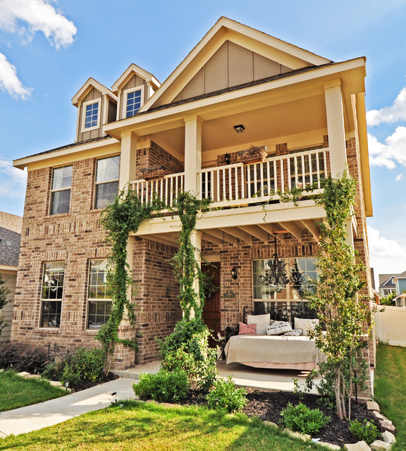 Traditional two-story brick exterior home idea in Dallas