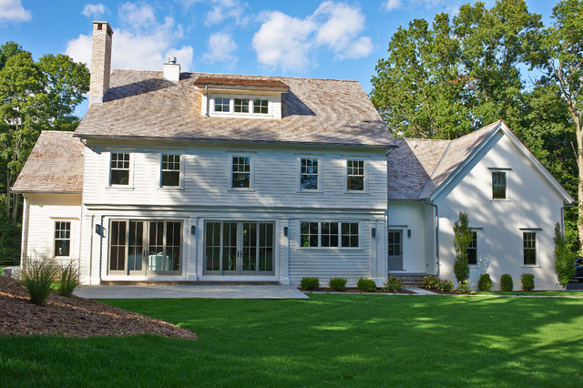 Inspiration for a cottage three-story exterior home remodel in New York