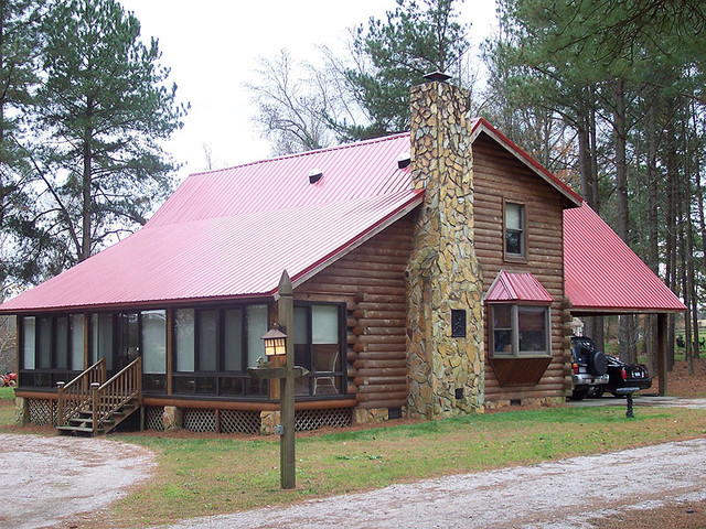 Red metal roof on cabin traditional exterior other Cabins with metal roofs