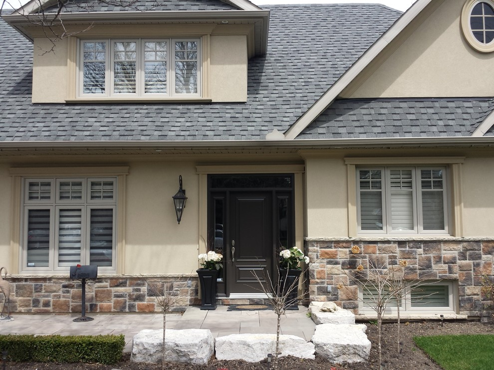 Example of a classic exterior home design in Toronto