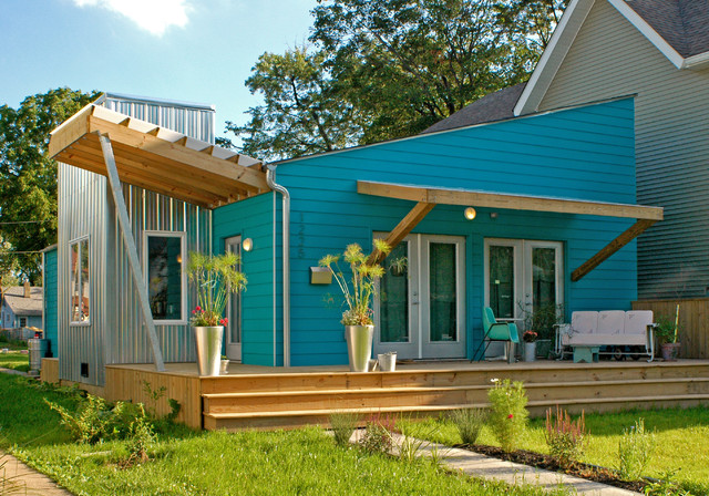 Small contemporary blue one-story mixed siding exterior home idea in Indianapolis