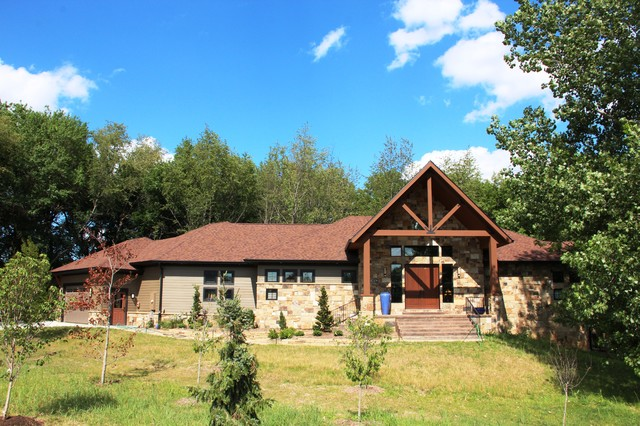 Mountain style brown one-story wood exterior home photo in Other with a shingle roof