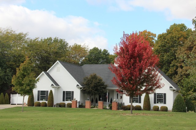 Inspiration for a timeless brown wood gable roof remodel in Other with a shingle roof