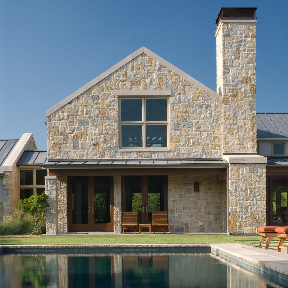 Example of a trendy stone exterior home design in Dallas