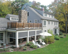 Retractable screens at classic New England Farmhouse traditional-exterior
