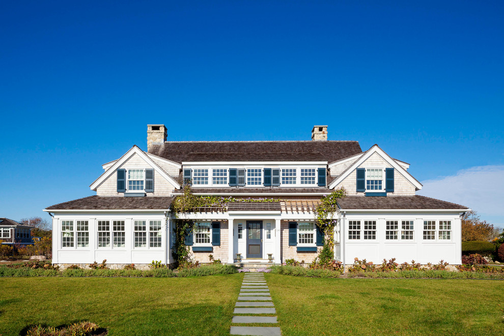 Inspiration for a large coastal two-story wood exterior home remodel in Providence